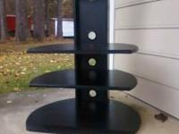 "3 tiered Flat screen tv stand. Holds up to 50"" tv."