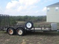 2005 Brewster 16 ft Flat bed utility trailer. Front and