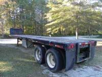 This is a 1987 steel frame flatbed trailer. It is road