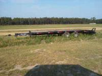 10 ton flatbed trailer, pintel hitch, very good rubber,