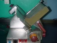 "Fleetwood Slicing Machines 10"" stainless steel slicer,"