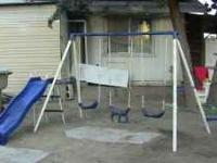 Flexible flyer metal swingset. Has 2 regular swings&1