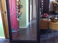 Full length floor standing mirror or can be hung on