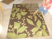 Brown & & green floor rug for sale. Great condition.