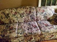 Hello, we are selling a floral couch in good condition.