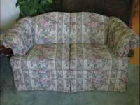 Floral couch and loveseat for sale in excellent