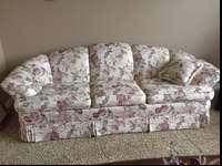 Floral couch plus 2 throw pillows- excellent condition.