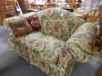 This is a quite quite & well made loveseat, floral