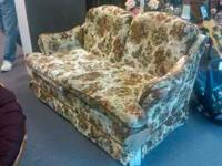 Floral print loveseat with no rips or tears, no broken
