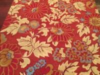 This a an appealing, eye-catching floral rug. It is an