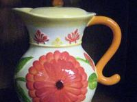 Very pretty decorative and usable pitcher with flower