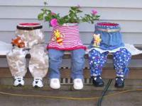 Flower pots that look like toddlers ideal for setting