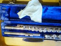 Nickle-plated flute with case that is in very good