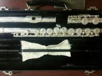 Used band flute on case, good condition. Slightly