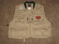 Men's size Large tan/khaki colored reversible fishing