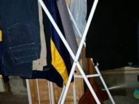 White folding laundry rack for sale. Folds for easy