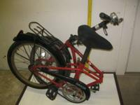 "FOLDING BICYCLE, 18"" WHEELS, ONE FLAT TIRE. GREAT TO"