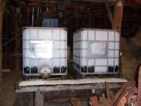 Square food grade water tanks with metal cage & pallet.