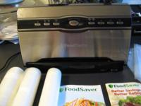 Up for sale are a silver and black Foodsaver machine