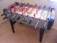 This a Sportscraft brand multi-game Foosball table for