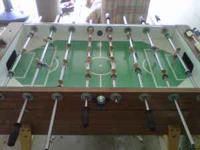 This is a very solid vintage foosball table in