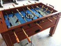 This is a foosball table that is in great shape. It is