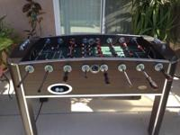This is a brand-new foosball table. The players have