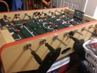 Brand new foosball table. Dimensions 55x45x35 inch.