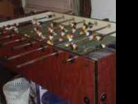 Foosball table brown in good conditon hardly used. Call