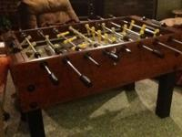 Foosball table in fantastic working condition. Heavy