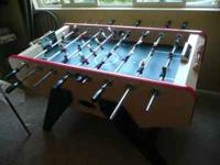 This is a hard-core foosball table. It is made of