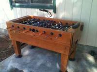 Foosball table is in excellent condition, very solid