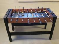 Foosball Table is in good shape, all poles/rods and
