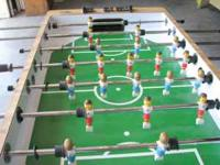 Regulation size Foosball table come with fifteen balls