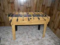 This is a really nice like new Foosball Table.Sturdy