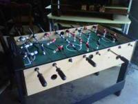 Fooseball / Air hockey table combo. One side has