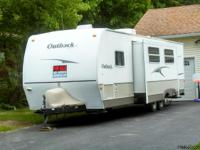 This is a 2008 Keystone Outback 30QBHS LE travel