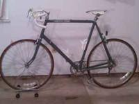 This 18spd Cannondale touring bike has a 68cm frame and