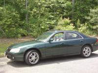 For Sale 2002 Mazda Dark Green 4 doors, Power windows,