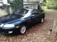 1993 Lexus sc300 for sale or for parts. Has body damage