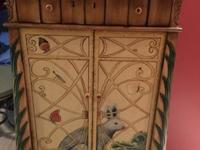 All wood wine cabinet with Rabbit painted. Has a top
