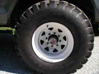 For Sale- 4 brand new tires with white spoke wheels.