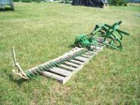 THE FIRST 300.00 CASH GETS THIS JD 451 SICKLER MOWER.
