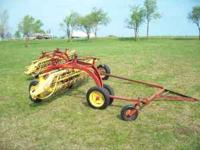 THIS NEW HOLLAND 258 HAY RAKE IS IN GREAT SHAPE FIELD