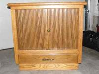 For Sale: Solid Oak TV Cabinet with bottom drawer and