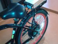 "Black and red Pedego electric bicycle with 26"" tires."