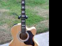For sale is a like new mint condition Takamine EG523SC