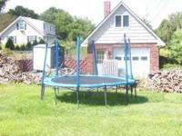 For Sale - Used Trampoline in good condition with net.