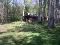 Perfect hunting & fishing retreat. Over 8 acres onthe