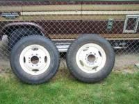 Four ford 1 ton dually wheels, two with rubber,